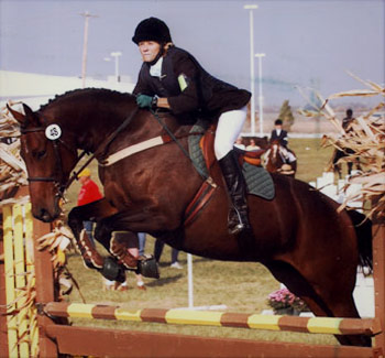 Seventh Farm: rider practicing jumping